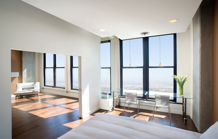 Editorial Architecture Photography: ultra modern bedroom and living room in lofty condo.
