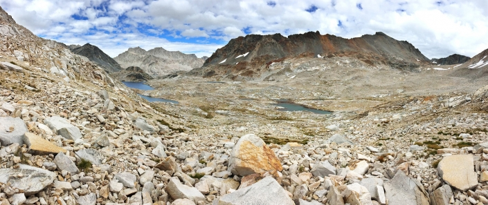 John Muir Trail mile 129. Panoramic landscape of Helen Lake, California from Muir Pass, California and the John Muir Shelter by Phoenix commercial photographer Jason Koster.