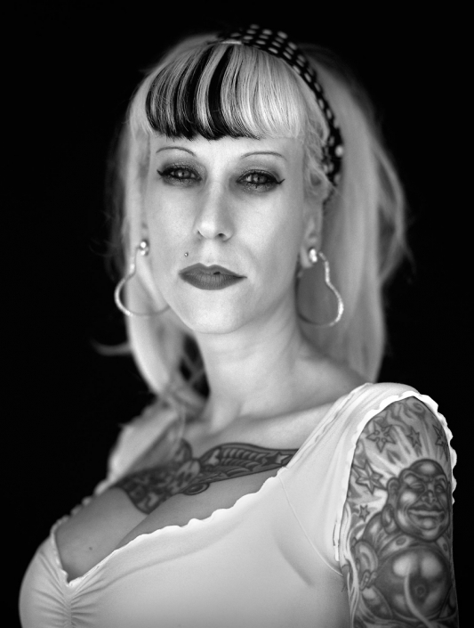 Black and White, Fine Art Portrait of a woman tattooed woman named Courtney at Viva Las Vegas by commercial photographer Jason Koster.