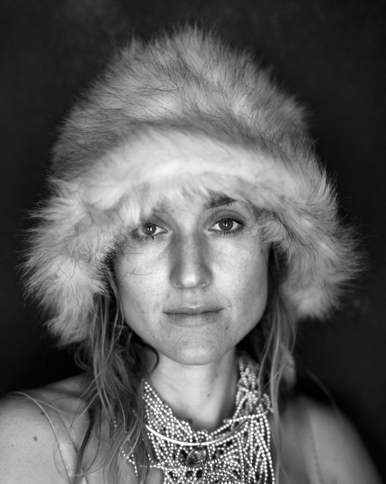 Black and White, Fine Art Portrait of woman with fur hat named Yulia at Burning Man by Phoenix commercial photographer Jason Koster.