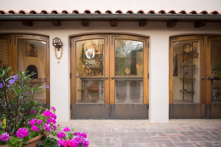 Editorial Architecture Photography: southwest style boutique exterior detail of old glass and wood doors.