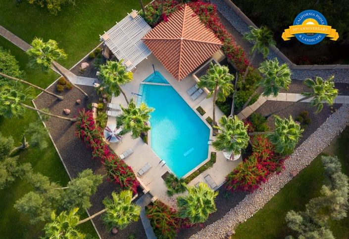 Phoenix commercial photographer Jason Koster creates beautiful aerial down shot of swimming pool, landscape & palm trees. Jason Koster is FAA 107 certified and is available for hire for drone operator and aerial photography.
