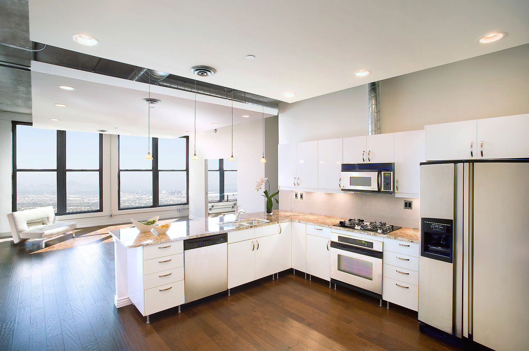 Editorial photography of architectural interior of contemporary kitchen in lofty condo by Phoenix commercial photographer Jason Koster