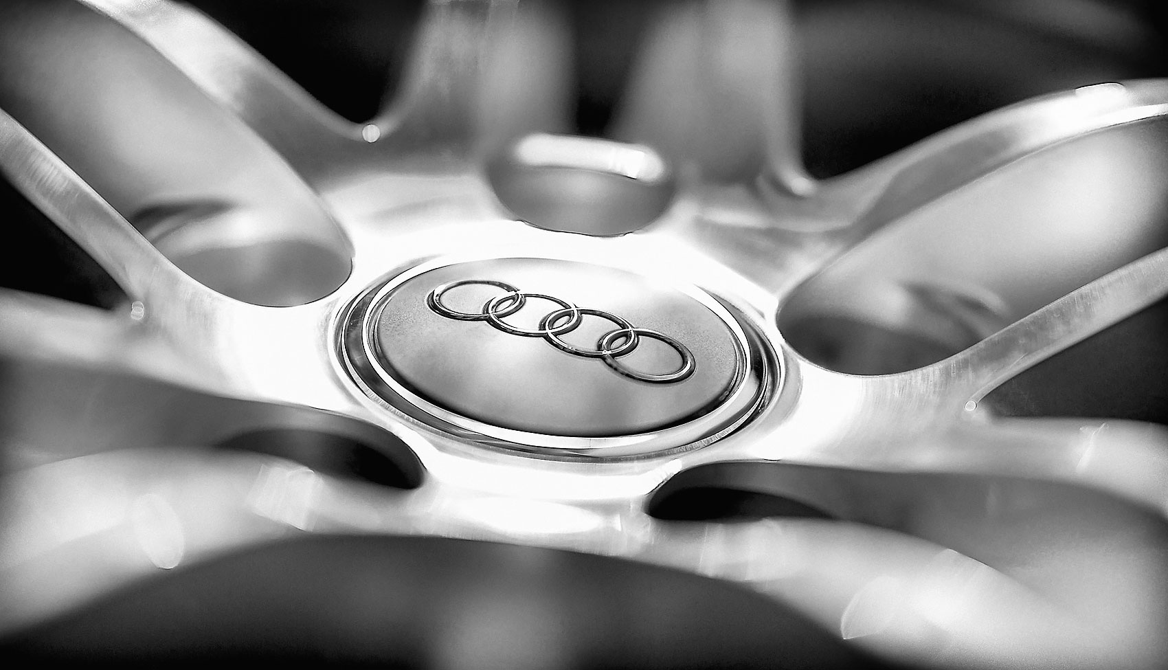 Editorial photography black and white abstract of Audi R8 wheel by Phoenix commercial photographer Jason Koster.