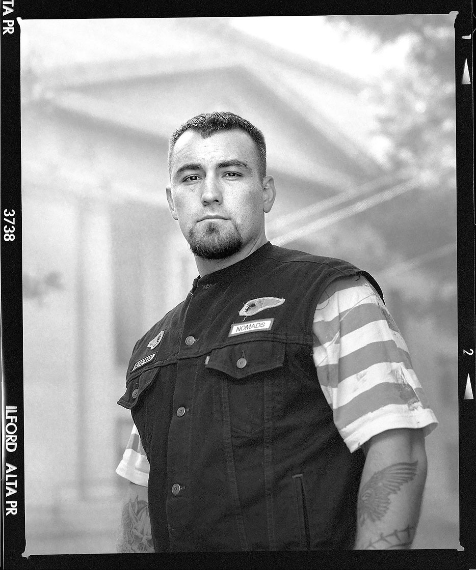 Editorial photography portrait of motorcycle club member with denim vest outside of Prescott Arizona Courthouse by Phoenix commercial photographer Jason Koster.