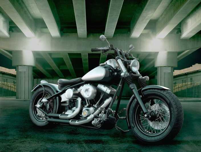 Custom motorcycle at night under the freeway