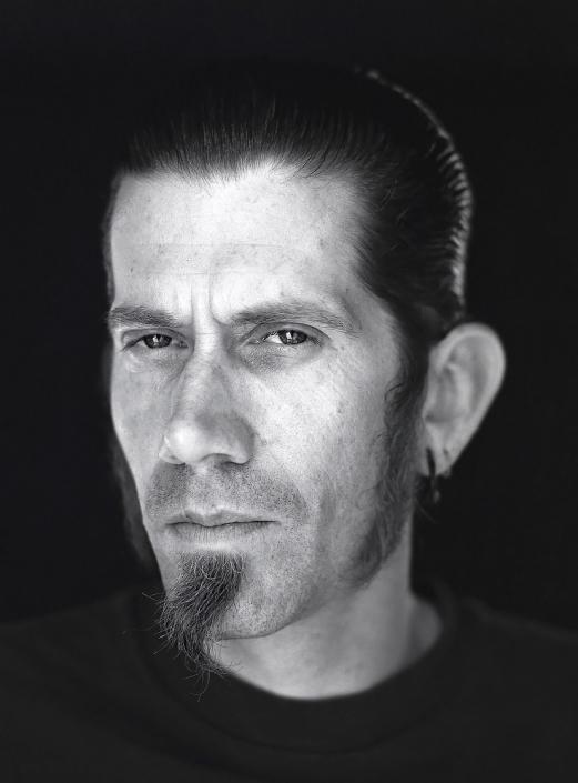 Black and White, Fine Art Portrait of a man named John at Viva Las Vegas by commercial photographer Jason Koster.