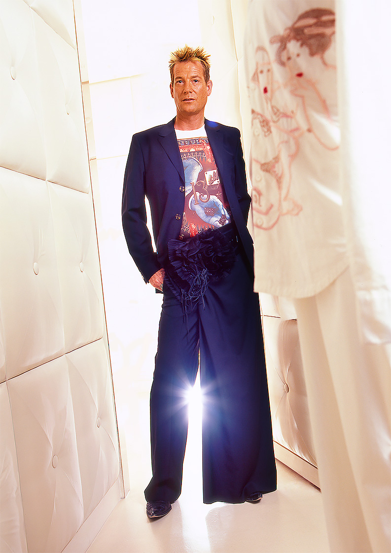 Editorial portrait of fashionable man in white Las Vegas dressing room. Shot by Phoenix commercial photographer Jason Koster for Vegas Magazine.